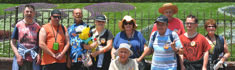 smiling group visiting Disney Land